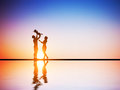Happy family together parents and their child celebrating little at romantic sunset birth mother father concepts Stock Images