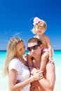 Happy family on tropic vacation having fun Stock Photos