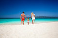 Happy family on tropic vacation mother father and daughter having fun tropical white beach Royalty Free Stock Photo