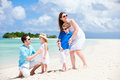 Happy family on tropical vacation Royalty Free Stock Images
