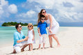 Happy family on tropical vacation young beautiful with two kids Royalty Free Stock Photos
