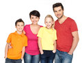 Happy family with two children on white photo of the young isolated background Royalty Free Stock Photography