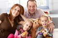 Happy family with two daughters and pregnant mother at home Royalty Free Stock Photo