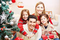 Happy family with two kids at christmas gifts Stock Image