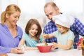 Happy family with two kids eating at home food children hapiness and people concept making dinner Royalty Free Stock Photography