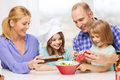 Happy family with two kids eating at home food children hapiness and people concept making dinner Royalty Free Stock Photo