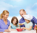 Happy family with two kids eating at home food children hapiness and people concept making dinner Stock Images