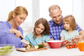 Happy family with two kids making dinner at home Royalty Free Stock Photo
