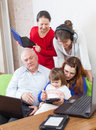 Happy family uses few electronic devices multigeneration various Royalty Free Stock Photography