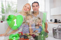 Happy family using interface to prepare dinner holographic green Royalty Free Stock Images