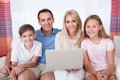 Happy Family Using Laptop Royalty Free Stock Photos