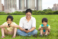 Happy family using smart phone and tablet pc outdoor Stock Photos