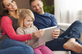Happy family using tablet smiling digital at home Royalty Free Stock Photos