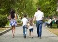 Happy Family Walking Along Sub...