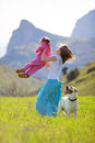 Happy family walking with dog Royalty Free Stock Photography