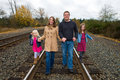 Happy Family Walking down train tracks Royalty Free Stock Photo