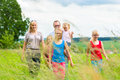 Happy family walking in the meadow with girls or daughters a summer Royalty Free Stock Photography