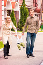 Happy family walking outdoor with a baby Stock Image