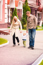 Happy family walking outdoor with a baby Royalty Free Stock Images