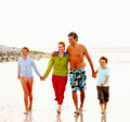 Happy family walking on the sea shore Royalty Free Stock Photography