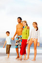 Happy family walking on the sea shore Stock Image