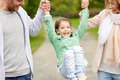Happy family walking in summer park and having fun happiness childhood people concept close up of mother father little girl Royalty Free Stock Photo