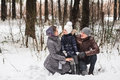 Happy family walking in a winter park. Royalty Free Stock Photo