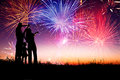 Happy family watching the fireworks standing on hill and Royalty Free Stock Photography