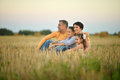 Happy family in wheat field Royalty Free Stock Photo