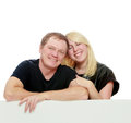 Happy family at the white banner. Royalty Free Stock Photo