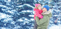 Happy family on winter walk. Dad and child baby girl Royalty Free Stock Photo
