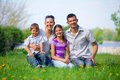 Happy family young couple with their children have fun at beautiful park outdoor in nature Stock Images