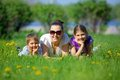 Happy family young mother with her children have fun at beautiful park outdoor in nature Stock Images