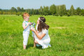 Happy family. Young mother and kid boy on sunny day. Portrait mom and son on nature. Positive human emotions, feelings, joy. Royalty Free Stock Photo