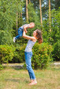 Happy family. Young mother throws up baby on sunny day. Positive human emotions, feelings, joy Royalty Free Stock Photo