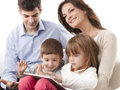 Happy family young sitting on sofa in living room Stock Photos