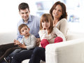 Happy family young sitting on sofa in living room Stock Photo