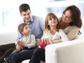 Happy family young sitting on sofa in living room Royalty Free Stock Photo