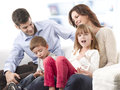 Happy family young sitting on sofa in living room Stock Image