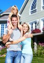 Happy family young smiling with children near new home Stock Image