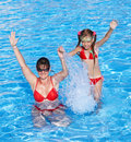 Happy familyl learn child swim in swimming pool. Stock Photography