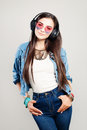 Happy Fashion Girl Enjoying the Music. Young Beautiful Woman Royalty Free Stock Photo