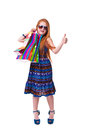 Happy fashion little redhead girl with shopping bags. Royalty Free Stock Photos