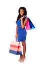 Happy fashion shopping bags beautiful smiling woman with wearing blue dress and belt on white Stock Photos
