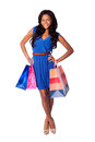 Happy fashion shopping bags beautiful smiling woman with wearing blue dress and belt on white Royalty Free Stock Images