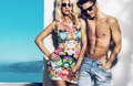 Happy fashionable couple on sunny vacation day Royalty Free Stock Photo