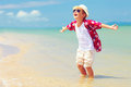 Happy fashionable kid boy enjoys life on summer beach sand Stock Photography