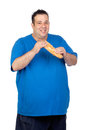 Happy fat man with a large bread Stock Images