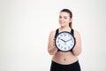 Happy fat woman holding clock Royalty Free Stock Photo