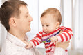 Happy father with adorable baby Stock Photography